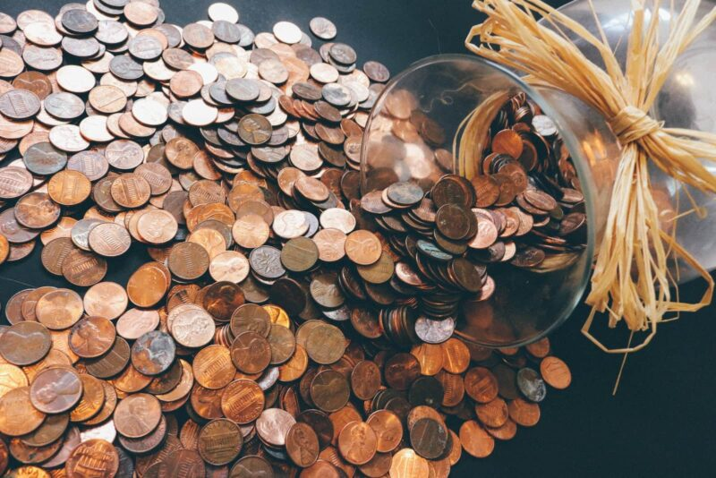 Several pennies laid across table, investing